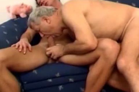 mature dad With Younger bang On couch